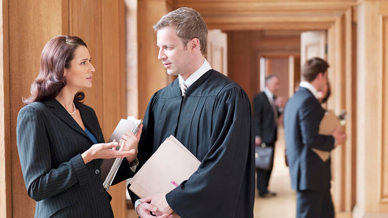 legal wigs in modern courtrooms - barristers talking