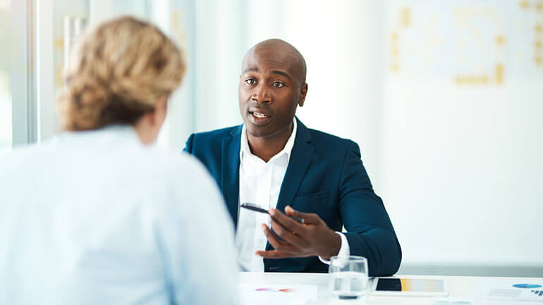 lawyer speaking to client